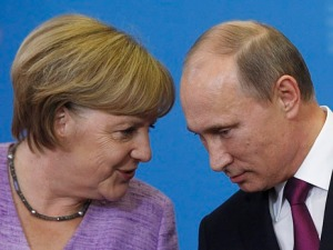 Russia's President Putin and Germany's Chancellor Merkel attend a news conference after their meeting at the St. Petersburg International Economic Forum in St. Petersburg